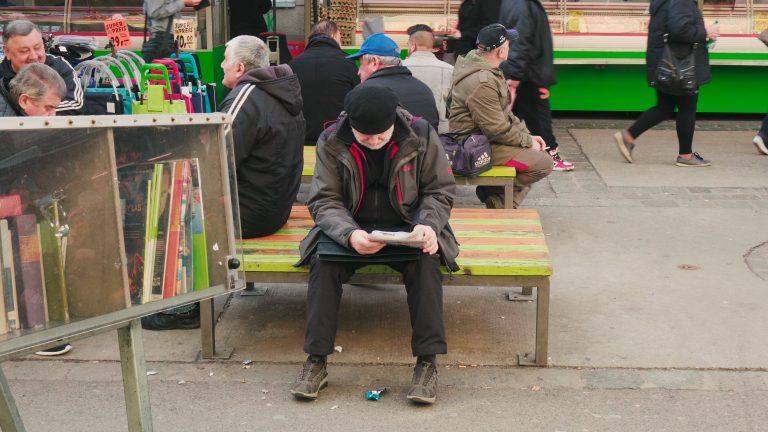 Reading a book in Brunnenmarkt